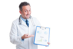 Doctor or medic presenting medicine sales and financial predicti Royalty Free Stock Images