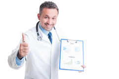 Doctor or medic showing medicine sales and financial prediction Stock Photo