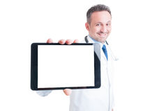 Doctor or medic showing tablet with blank display Royalty Free Stock Image