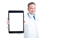 Doctor or medic showing tablet with blank screen Royalty Free Stock Photo