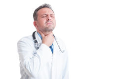 Doctor or medic suffering of sore throat Royalty Free Stock Photo