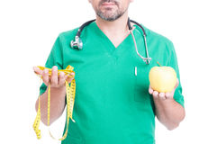 Doctor or medic with tape line and apple stock photography