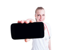 Doctor or medic woman showing mobile phone with black screen Stock Photos