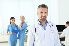 Doctor and medical assistants in clinic. Health care service stock photography