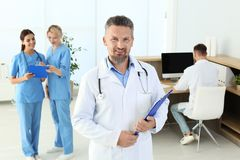 Doctor and medical assistants in clinic. Health care service royalty free stock photography