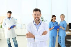 Doctor and medical assistants in clinic. Health care service royalty free stock images