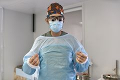 Surgeon in operating room. Doctor in medical clothes looks into the camera in the operating room. Closeup. Horizontal Royalty Free Stock Photography