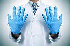 A doctor with medical gloves Stock Photo