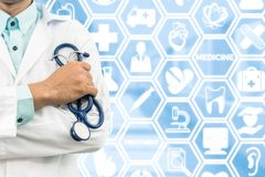 Doctor on medical icons background royalty free stock image