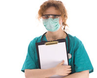 Doctor in medical mask holding clipboard Royalty Free Stock Image