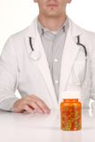 Doctor With Medication in Prescription Bottles Royalty Free Stock Images