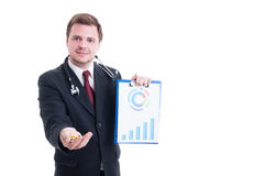 Doctor or medicine salesman offering pills and showing charts Royalty Free Stock Photography