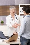 Doctor meeting patient Stock Image