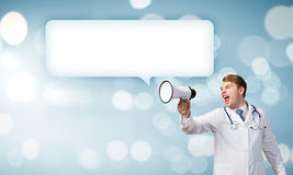 Doctor with megaphone Royalty Free Stock Photos