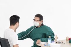 Doctor man patient examination with man on white background. stock photo