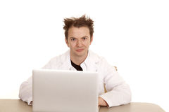 Doctor messed up hair computer looking Royalty Free Stock Photography