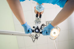 Doctor with a microscope in a dental clinic Royalty Free Stock Photos