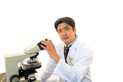 Doctor with a microscopic examination Royalty Free Stock Image