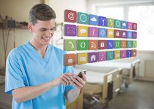 Doctor on mobile phone with apps icons in hospital room. Digital composite of Doctor on mobile phone with apps icons in hospital room Royalty Free Stock Photography