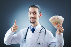 Doctor with money. In studio Royalty Free Stock Photos