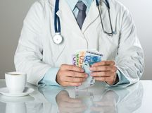 Doctor with money Stock Photography
