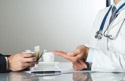 Doctor with money Stock Photos