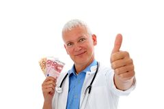 Doctor with money and thump up. Smiling Doctor with money, stethoscope and thump up Royalty Free Stock Images