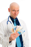 Doctor with money in white lab coat Stock Photo