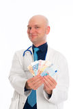 Doctor with money in white lab coat Stock Image