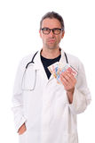 Doctor with money Royalty Free Stock Photography