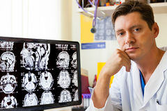 Doctor at monitor with an MRI scan. Of the Brain on Monitior stock image
