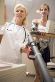 Doctor Monitoring Female Patient On Treadmill Royalty Free Stock Images