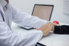 Doctor is monitoring the patient`s symptoms. royalty free stock photos