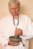 Doctor with mortar and pestle Royalty Free Stock Photo