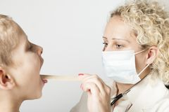 Doctor with mouth protection in white room Royalty Free Stock Image