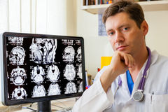Doctor with an MRI scan of the Brain. On Monitior royalty free stock image