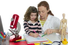 Doctor natural sciences teaching school pupil. Doctor natural sciences teaching pupil at school Royalty Free Stock Photos
