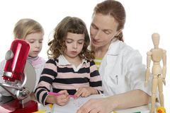 Doctor natural sciences teaching school pupil Stock Photos