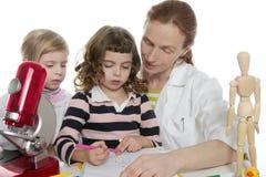 Doctor natural sciences teaching school pupil. Doctor natural sciences teaching pupil at school Stock Photos