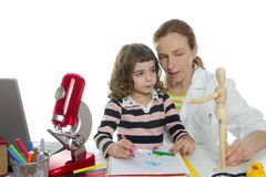 Doctor natural sciences teaching school pupil. Doctor natural sciences teaching pupil at school Royalty Free Stock Photography