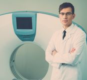 Doctor near computed tomography scanner Royalty Free Stock Images