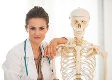 Doctor near human skeleton anatomical model Stock Photography