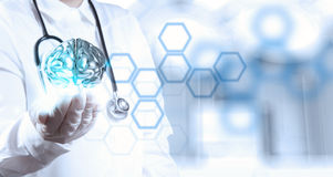 Doctor neurologist hand show metal brain. With computer interface as concept Stock Photography