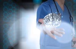Doctor neurologist hand show metal brain Stock Photos