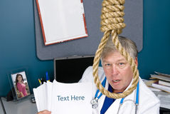 Doctor and noose with reform bill Royalty Free Stock Photos