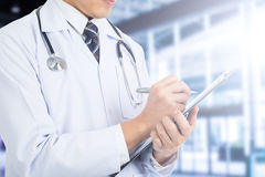 Doctor note his report for checkup patient Royalty Free Stock Images
