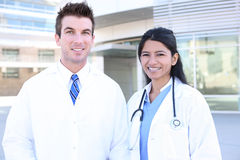 Doctor and Nurse. Hansome man doctor and woman nurse outside hospital Royalty Free Stock Photos