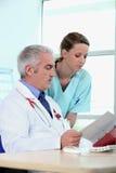 Doctor and nurse Stock Photos