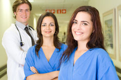 Doctor and nurse. Group portrait of doctors and nurses in hospital hallway royalty free stock photos