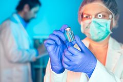 Doctor and nurse analyzing unknown MMR vaccine. In medical clinic hospital royalty free stock image